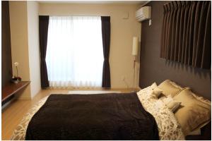 寝室は落ち着いた配色とし、安らぐ空間にしています。